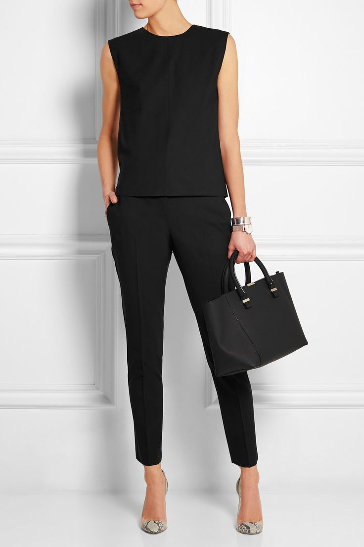 matched set of black sleeveless top & tailored tapered pants, so chic