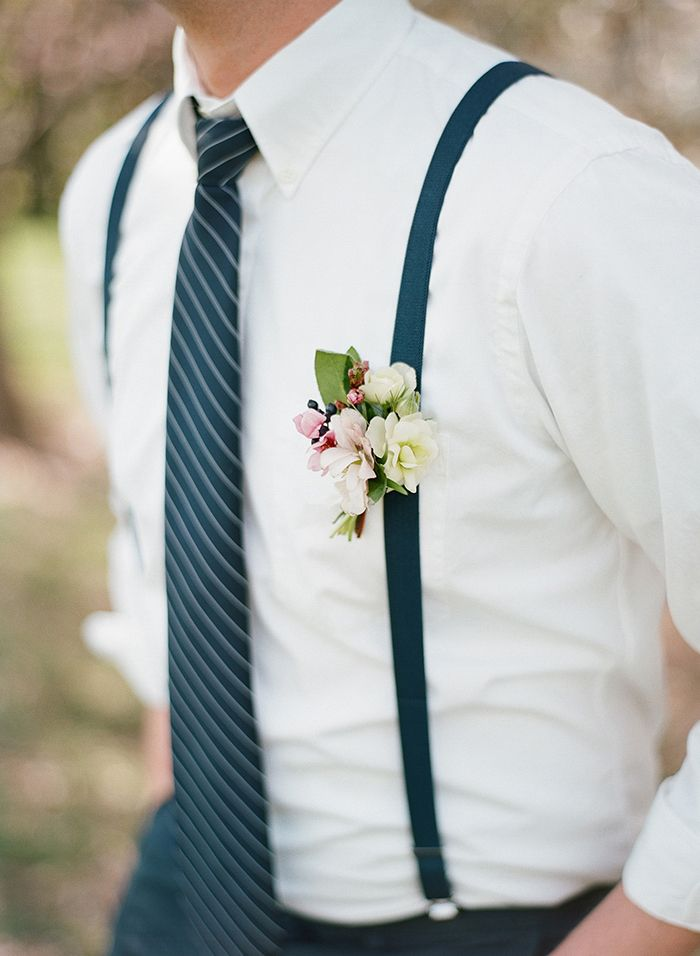Groom with Suspenders and a Navy Striped Tie