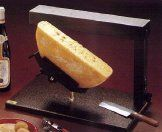 This is the typical restaurant type raclette machine for half-wheels.  If you like cheese, this is it.