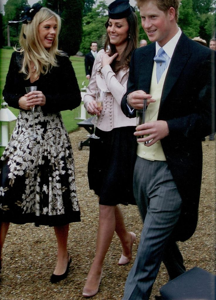 Kate Middleton, Chelsy Davy, and Prince Harry attend the wedding of Peter Philips and Autumn Kelley's wedding at St. George's Chapel in Windsor, May 17, 2008. This was the first time Kate officially met the Queen. Prince William did not attend.