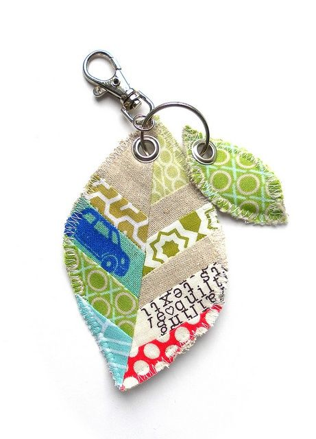 Scrappy Leaf keyring by Flying Blind On A Rocket Cycle, via Flickr. I love the use of the grommets and the combination of linen and other fabrics
