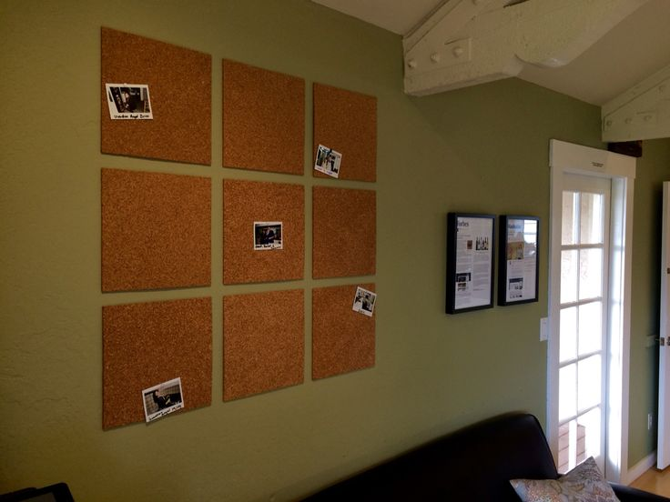 cork board tiles with polaroids for a photo wall all it needs now is more