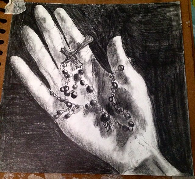 Tonal drawing of hand with rosary beads