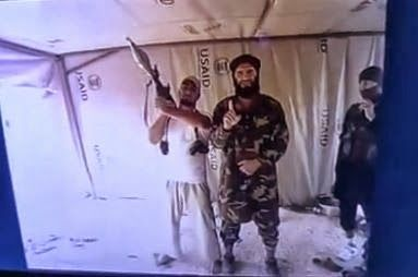 Photo Proof- al-Qaeda Inside US AID Tent (Video) - The officially designated terror group is now in Syria, working hand in hand with the Free Syrian army rebels & along with online videos showing the groups merging ceremony & firing off chemical weapons, plus public knowledge that the Obama Admin. is providing weapons to the rebels, this is just further proof that in order to remove the Assad regime in Syria, the US, under Obama, is willing to sell it's soul to actively work with & aid…