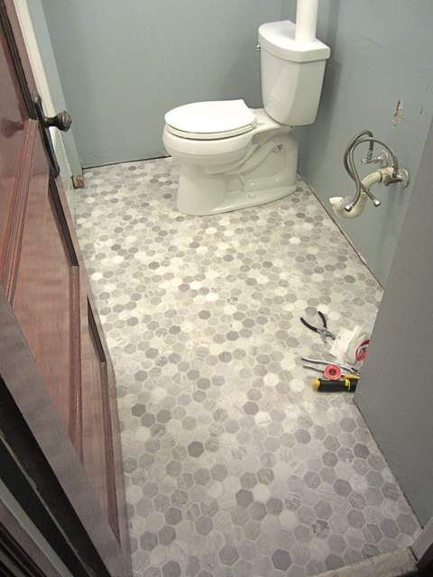 Best 25 vinyl flooring bathroom ideas on pinterest for Basement bathroom flooring ideas