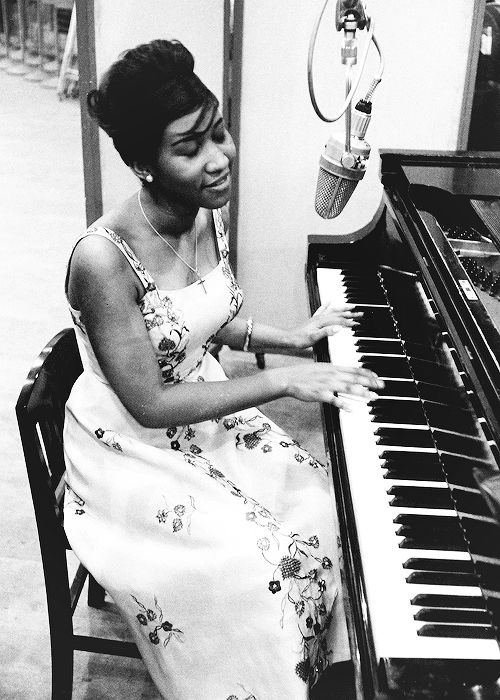 Aretha Franklin sings and plays the piano during a recording session for Columbia Records, New York, 1960.
