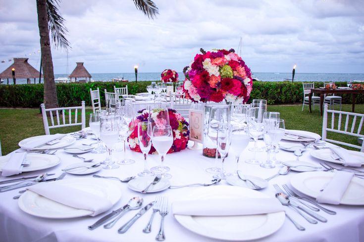 Let the brightness of the reception flowers contrast beautifully against a white tablescape here at Zöetry Paraiso de la Bonita! #DestinationWedding #WeddingFlowers #ReceptionDecor