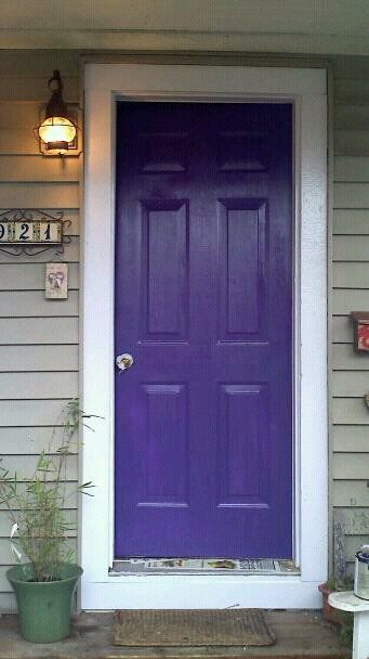 Subdued Green House with Purple Door and white trim. I love it.