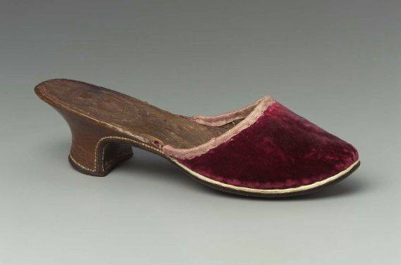 Red silk velvet mule with pink silk binding alond top. Pointed toe. Brown leather Louis heel. Dark brown leather sole. White leather welt; leather lining and insole stamped with arms of Conti family. #44.565 French, 1775–1800   Museum of Fine Arts, Boston