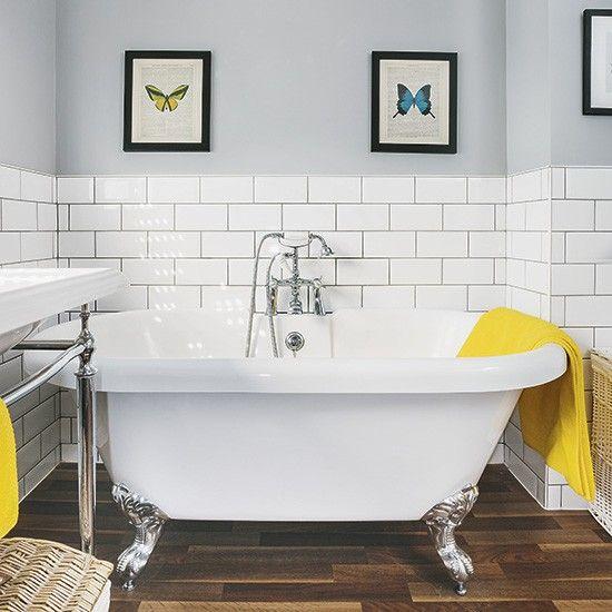 Modern bathroom with metro tiles and wood-effect floor