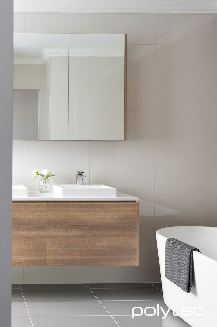 Sleek looking modern bathroom vanity in polytec RAVINE Sepia Oak.