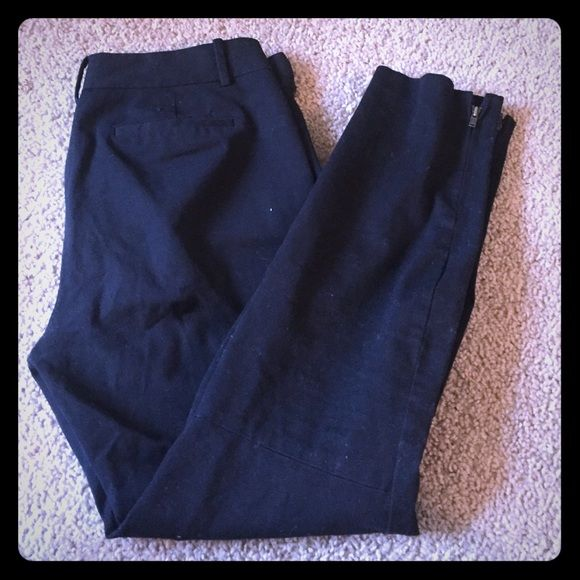 Black ankle pants Very cute black ankle pants. There is a side zipper that is missing the latch at the top (pictured) but in otherwise great condition! These are a size 6short Maison Jules Pants Ankle & Cropped