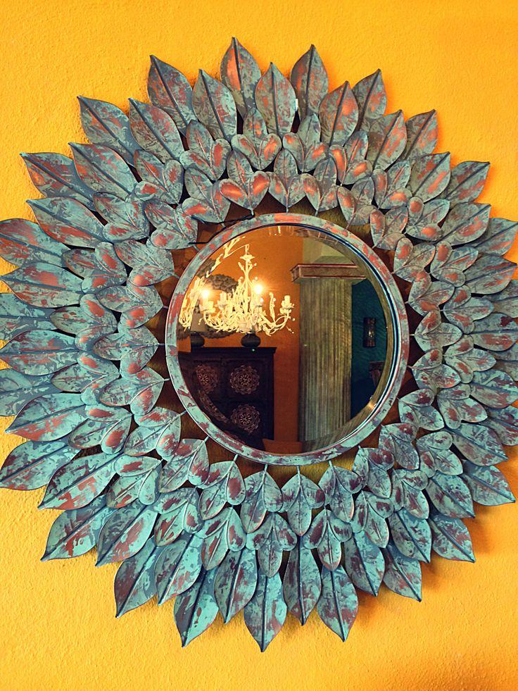 Espejo sol en turquesas.