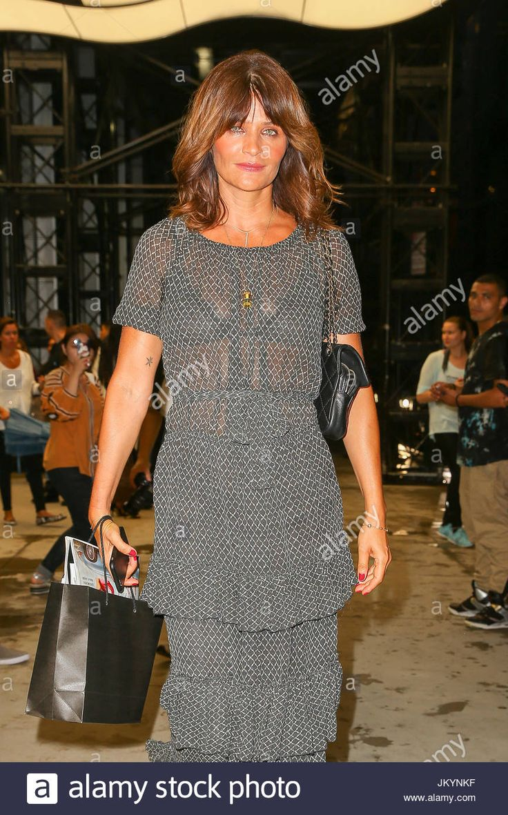 Helena Christensen. Model Helena Christensen wears a see-through garb as leaving the Park Hyatt Hotel after attends The Daily Front Row's Third Annual Fashion Media Awards in New York City Stock Photo