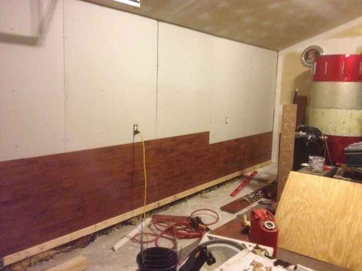 Using laminate flooring as a wall covering the wolven for Laminate floor covering