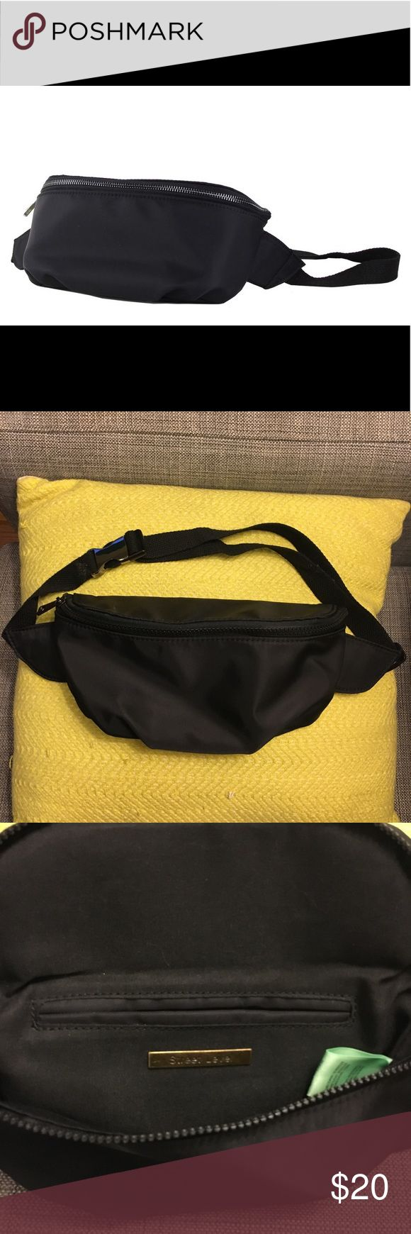 Street Level nylon fanny pack Black nylon fanny pack with adjustable buckle belt. One interior pocket and log plate. Supet sturdy. Fanny packs are making a huge comeback and i love this for concerts, music festivals or (from a practical viewpoint) sport activities. This bag is very simple so its easy to mix in to your wardrobe! Brand new and never worn, although i dont actually have a tag on it. Street Level Bags