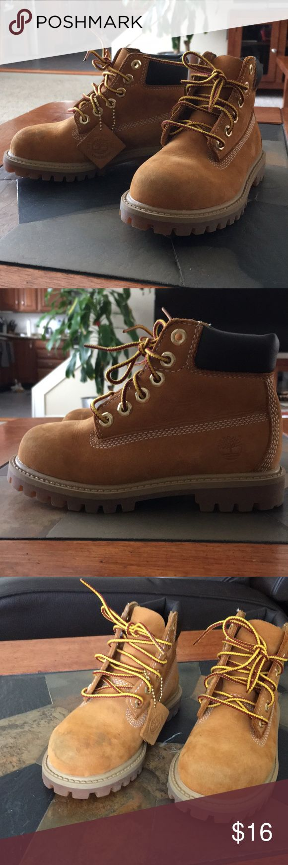 Toddler Timberlands Size 10 tan toddler Timberland boots. So tough and rugged. Minimal wear, but toes have marks and I'm afraid to clean them. Timberland Shoes Boots