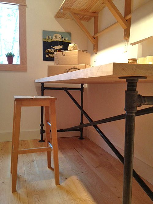 Table legs constructed with scaffolding poles: Cafe Cartolina: New Shipping room - and a DIY table for you!