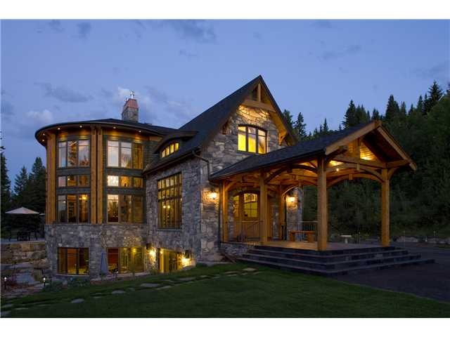 Valley Ridge Pa NW, Calgary  Exquisite Timberframe executive family home elevated 50 feet above the Bow River in a forested park like acreage setting surrounded by environmental reserve, towering conifers and privacy.