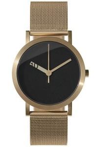 Los relojes Normal son diseñados en Japón por Ross McBride, creados con una inspiración minimalista y utilizando materiales de alta calidad. Su tamaño es de 38 mm, es resistente al agua, su material es acero color dorado.