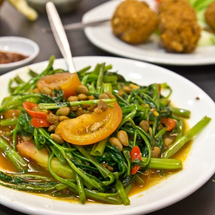 Kangkong Tauco. Kangkong is one of the most eaten vegetable in Indonesia. It is crunchy and juicy. In this dish, kangkong is cooked with tauco (fermented soy bean paste).