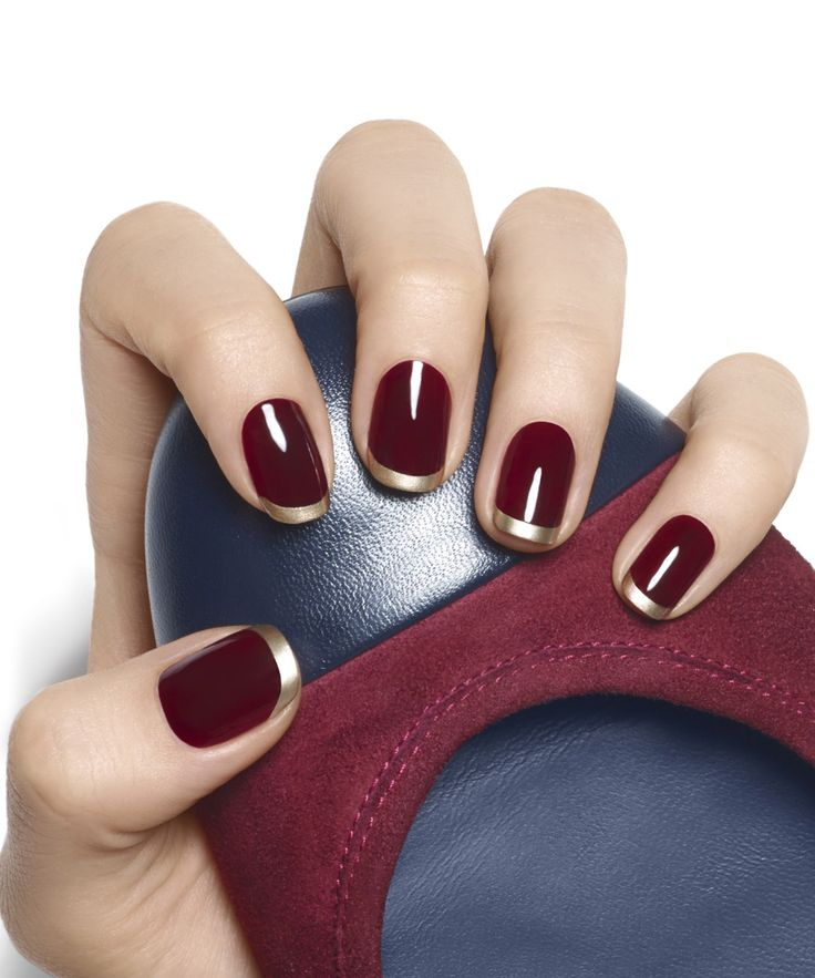 Dark, decadent, rich. This gilded french manicure in deep luscious berry is totally unexpected and utterly flawless. Essie's Naughty Berry and Good as Gold