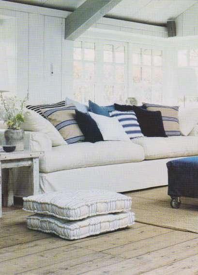 love couch, pillows, denim ottoman on wheels, furniture finish......