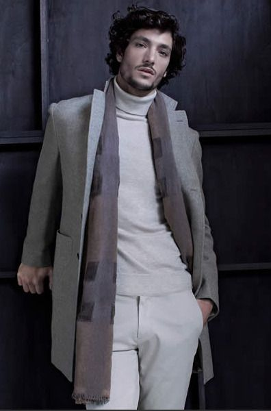 Team a grey overcoat with grey chinos to create a smart casual look.   Shop this look on Lookastic: https://lookastic.com/men/looks/grey-overcoat-grey-turtleneck-grey-chinos/15817   — Grey Turtleneck  — Grey Scarf  — Grey Overcoat  — Grey Chinos