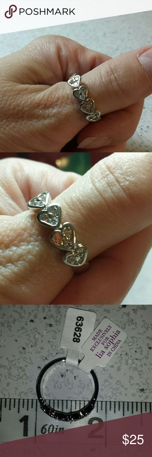 """NWT Lia Sophia size 9 Silver """"Admire"""" Ring Lia Sophia, New with tags, 4 very pretty silver hearts with tiny crystals, size 9 Lia Sophia Jewelry Rings"""