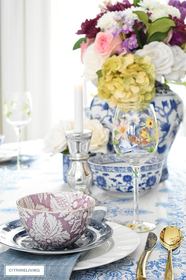 AN EASTER TABLESCAPE WITH BLUE AND WHITE