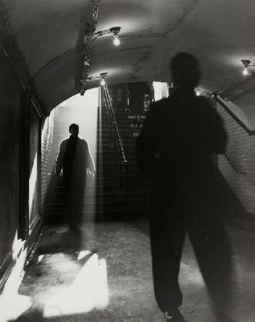 by Sabine Weiss, Paris, 1950 heavenly light. juxtaposition between lite and dark figure nd their connection. cold like the subway