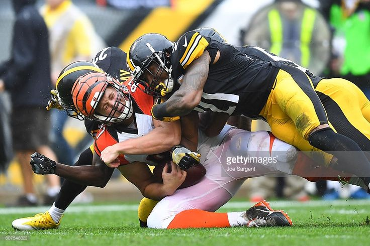 Tyler Kroft #81 of the Cincinnati Bengals is brought down by Robert Golden #21 and Mike Mitchell #23 of the Pittsburgh Steelers in the first quarter during the game at Heinz Field on September 18, 2016 in Pittsburgh, Pennsylvania.