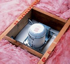Hold back insulation from recessed lights in the ceiling beneath the attic floor. Photo: Johns Manville
