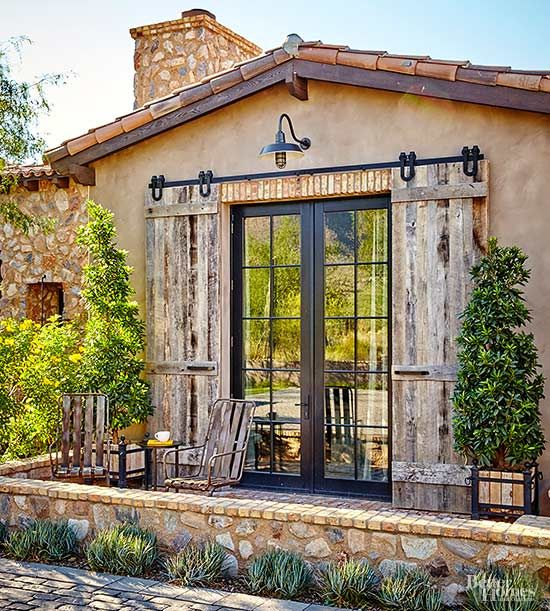 There's no random decorating in this house. Exterior stone and wood detailing is carried throughout the home's exterior and interior alike. Subtle greenery and wooden patio furniture add charm to the home's many outdoor seating areas./