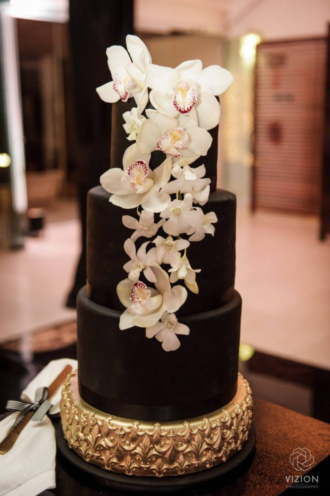Elize & Stefan - Wedding Showcase | The Aleit Group  Black and gold wedding. Black and gold wedding cake. Lilly decorations. Cake Maker. Laurent Venue. Vizion Photography and Films. South Africa.