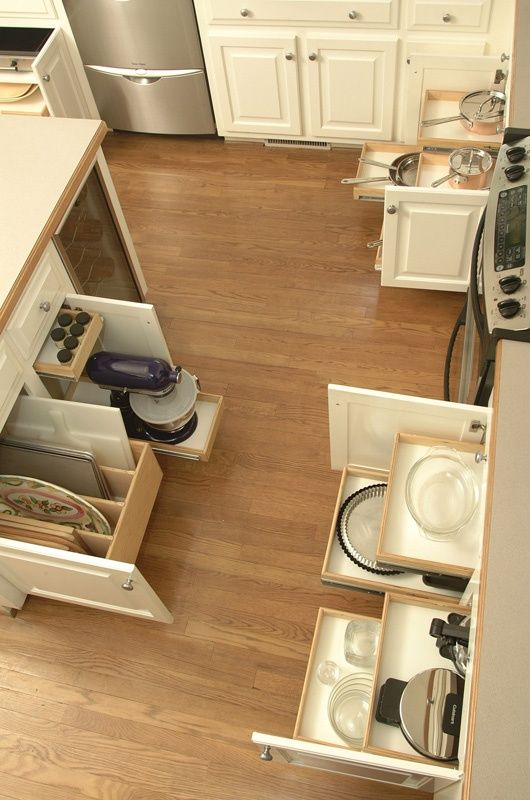 Pull out drawers for pots and pans under stove.  Kitchen organization by Shelf Genie