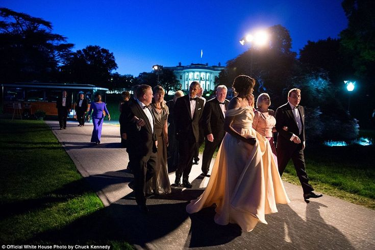 Michelle, dressed in a Naeem Khan gown, escorts the Nordic leaders and their spouses to a ...