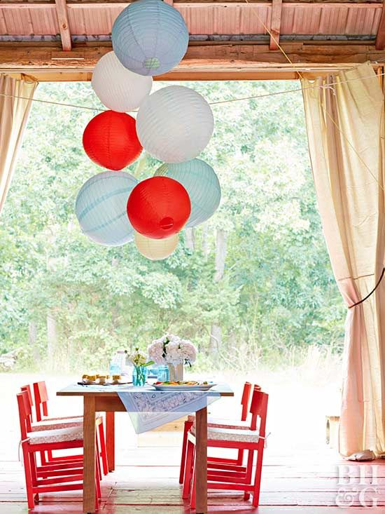 Red, white, and blue lanterns become bubbly America-theme decorations over your dining table. Use a long piece of sturdy string and tie each of the lanterns onto it. Fold the string in half before hanging to create a layered look.
