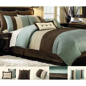 I have this comforter set and I love the warm blue and brown tones.  It's the perfect color scheme