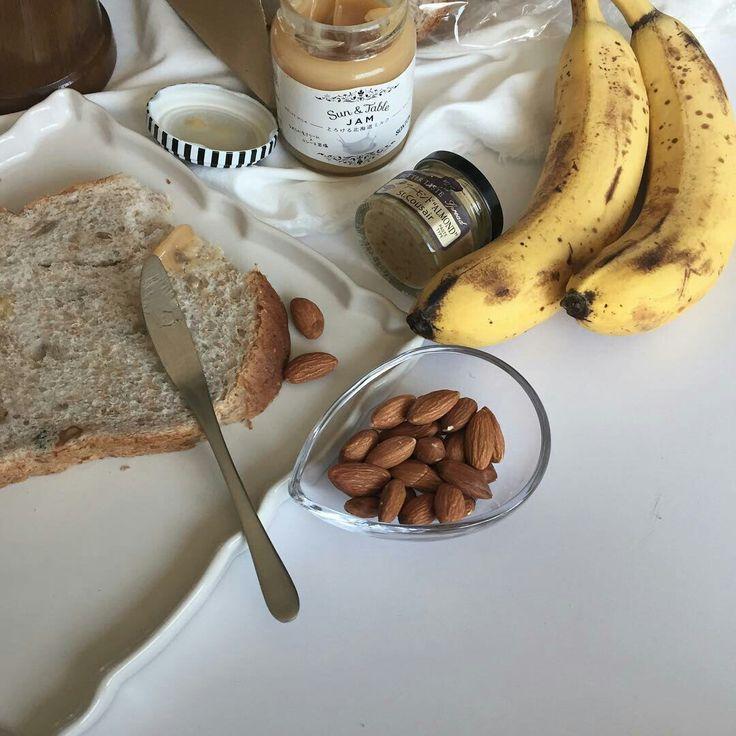 breakfast table: toast, jam, honey, almonds and bananas // pinterest @softcoffee