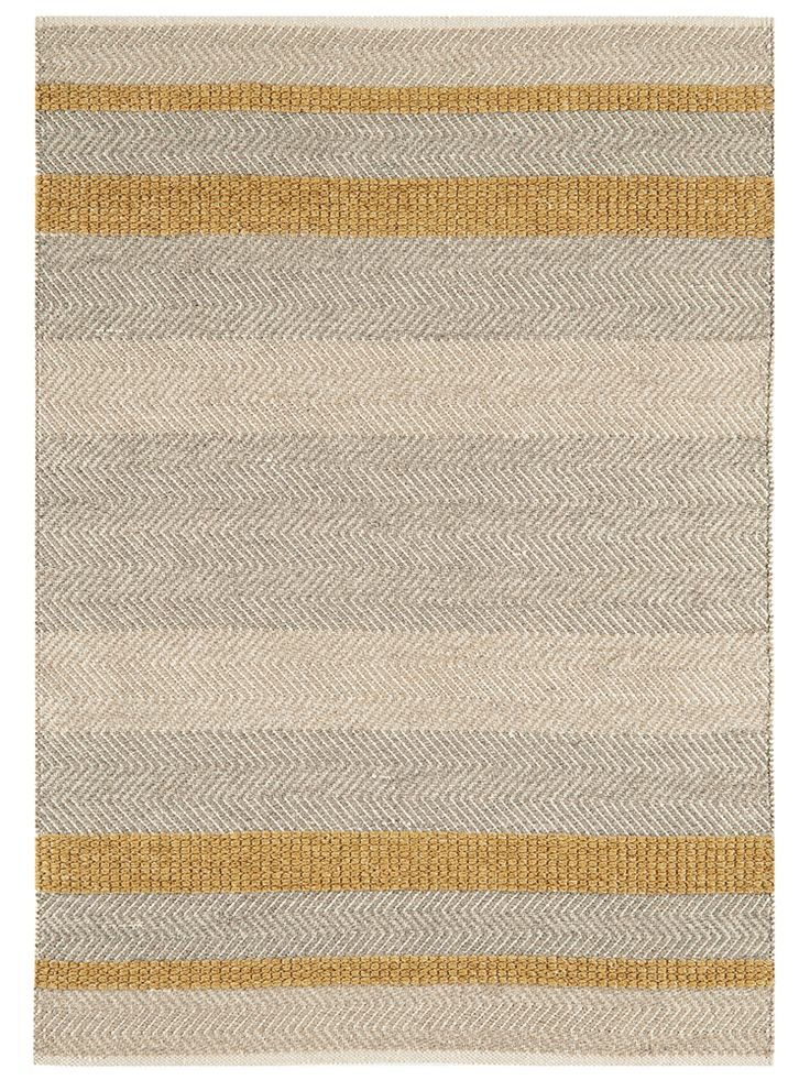 Carefully handmade from a wool, cotton and viscose blend that is both beautiful and hardwearing, our flat weave rug has a rustic, waved edge and unique details. With blended shades of grey, cream and soft mustard yellow, it adds a subtle colour accent to your room and looks perfect on wooden, stone or laminate flooring. Also available in flint, blue and forest green. This product is not available for Next Day Delivery in the UK and due to the size and weight of this item in Medium and Lar...