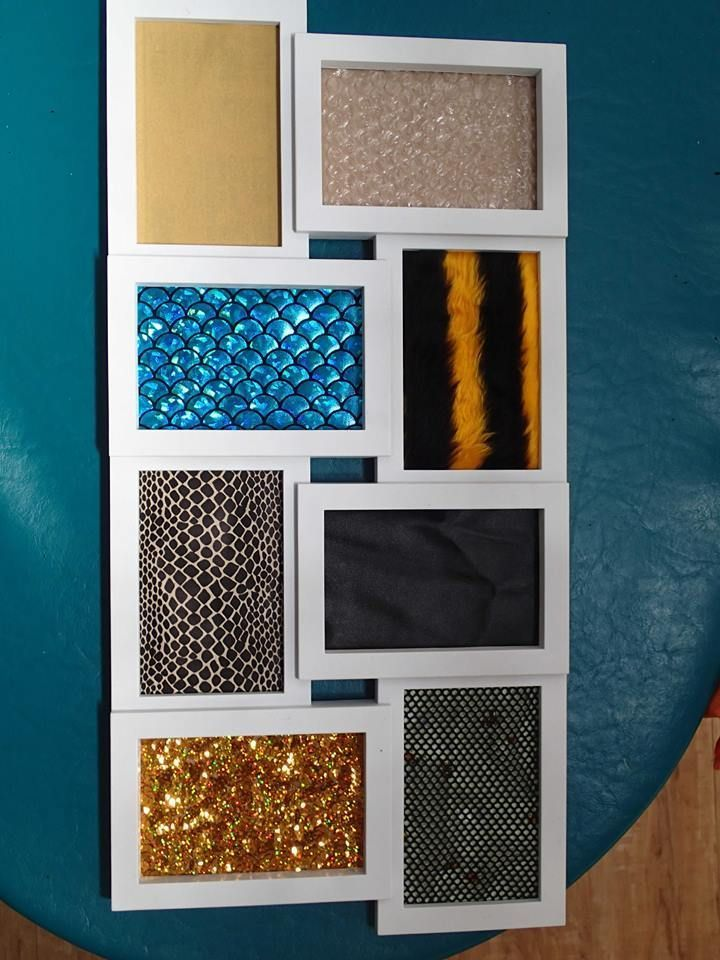 New sensory board made from a photo frame - bubble wrap, fine sand paper, silk fish scales, tiger fur, snake skin, leather, sequined material and fishnet over bees. Cheryl's Family Day Care. Pinned by The Sensory Spectrum pinterest.com/sensoryspectrum