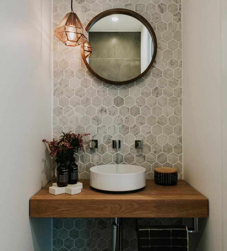 "49 Likes, 4 Comments - STUDIO BLACK INTERIORS (@studioblackinteriors) on Instagram: ""Make a statement in a tiny powder room. Carrara marble hexagon tiles offset by handmade timber…"""