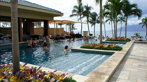 """The adults-only """"serenity pool"""" at the Four Seasons Resort in Maui offers an array of swim-up bars -- if the bubble lounge and panoramic views aren't enough to relax you."""
