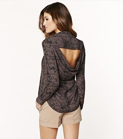 Show off your sexy back with this fabulous snake print open back button shirt!