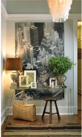 I like this look - clear acrylic console; super large black and white piece; brown shade on the lamp. from delight by design