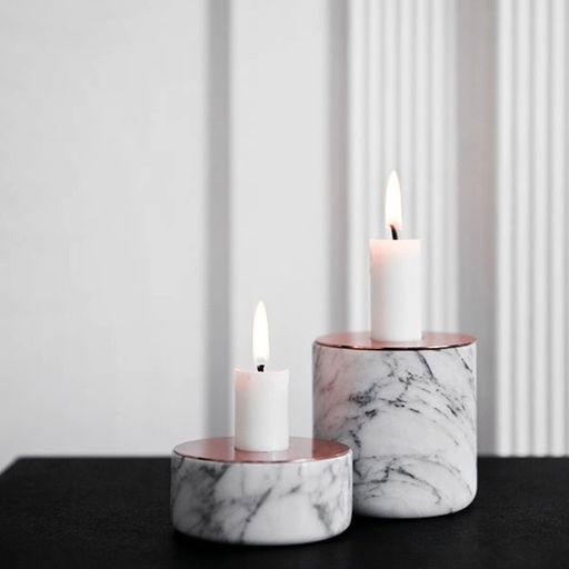 Tough on the outside, romantic on the inside. That's how designer Andreas Engesvik describes his Chunk collection of candleholders. The Menu Chunk of Marble Candleholder pairs a generously veined block of polished marble with a top plate of warm, reflective copper. The opening supports a single taper candle.
