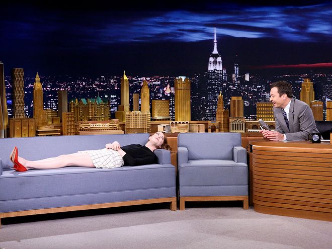 October 14, 2014 Emma Stone gets comfy during an interview with Tonight Show host Jimmy Fallon on Tuesday in New York City.