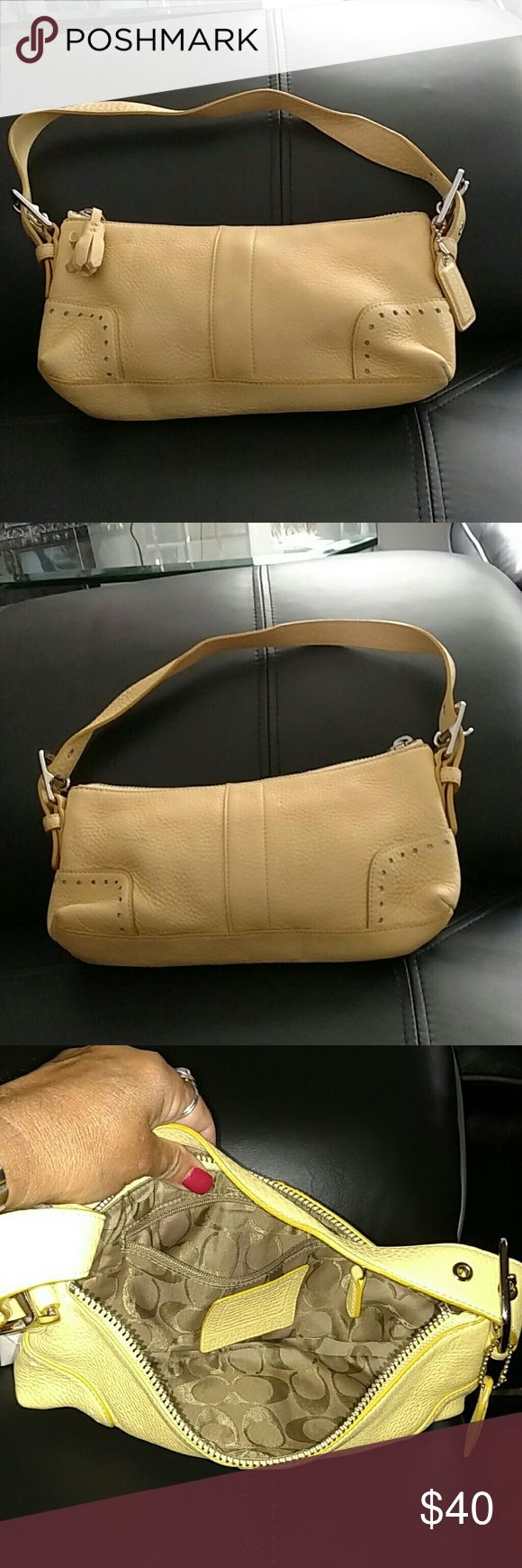 Authentic small yellow coach purse .. price firm i love this coach bag had it for a year. Never used. It's in excellent condition. With silver hard wear.. Coach Bags Mini Bags