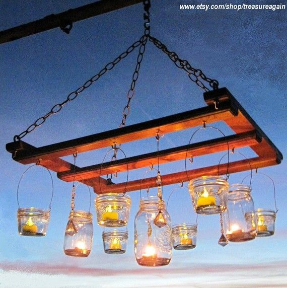 Have an extra pallet laying around??  Make a fun lighting concept, with mason jars hung from an old pallet.